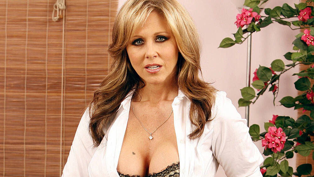 Married woman Julia Ann fucking in the desk with her tattoos