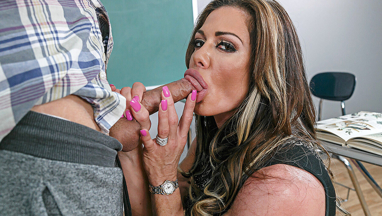 Mature Nina Dolci fucking in the desk with her medium tits